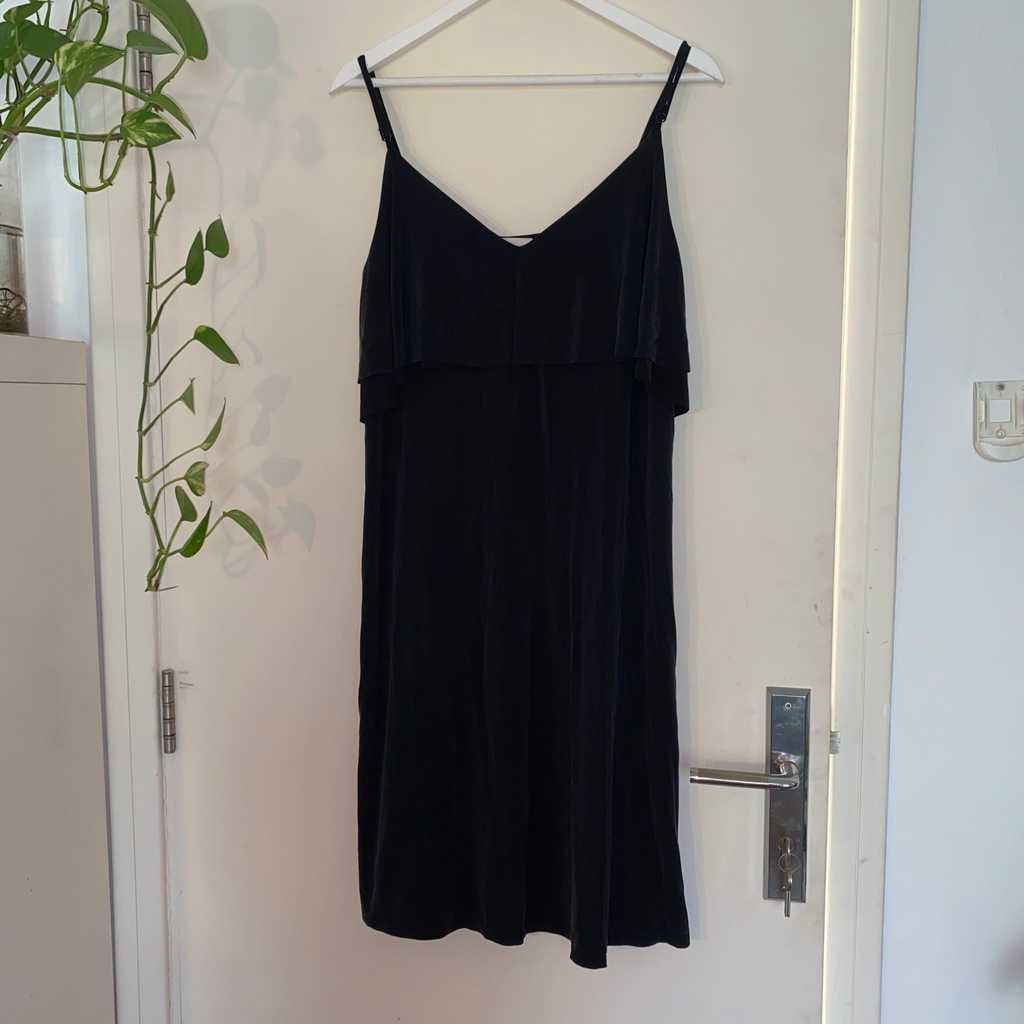 Loose fitting shift dress with tiered layer
