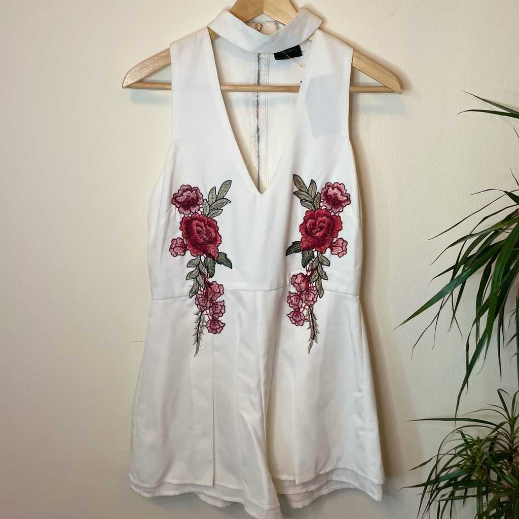Brand new white halter top with floral accent