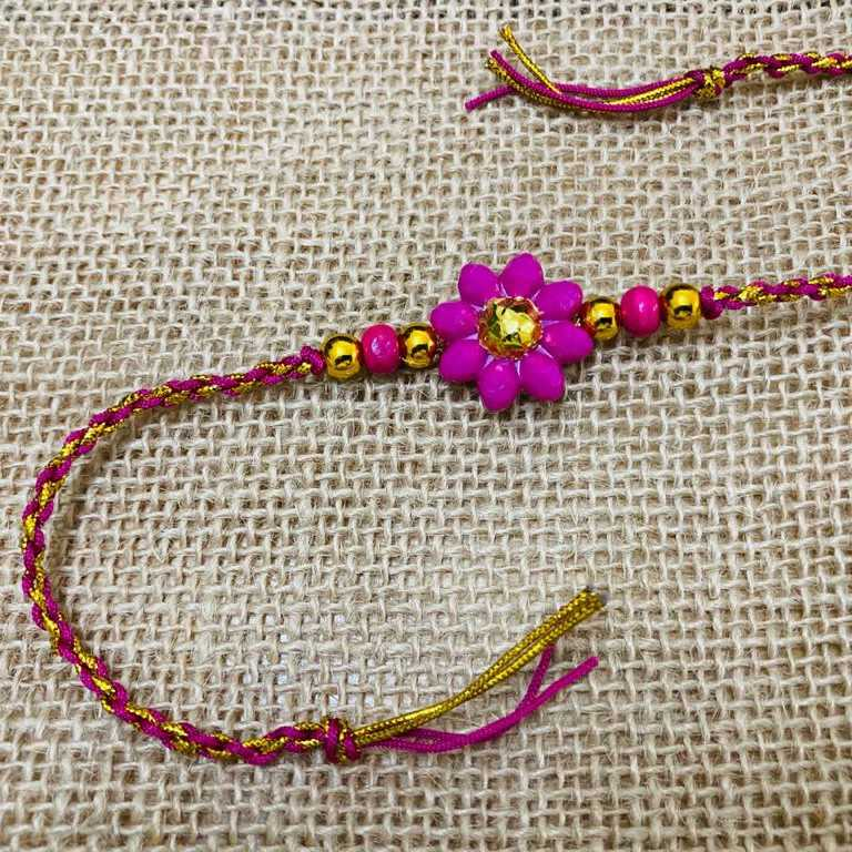 Golden rakhis with trendy colors