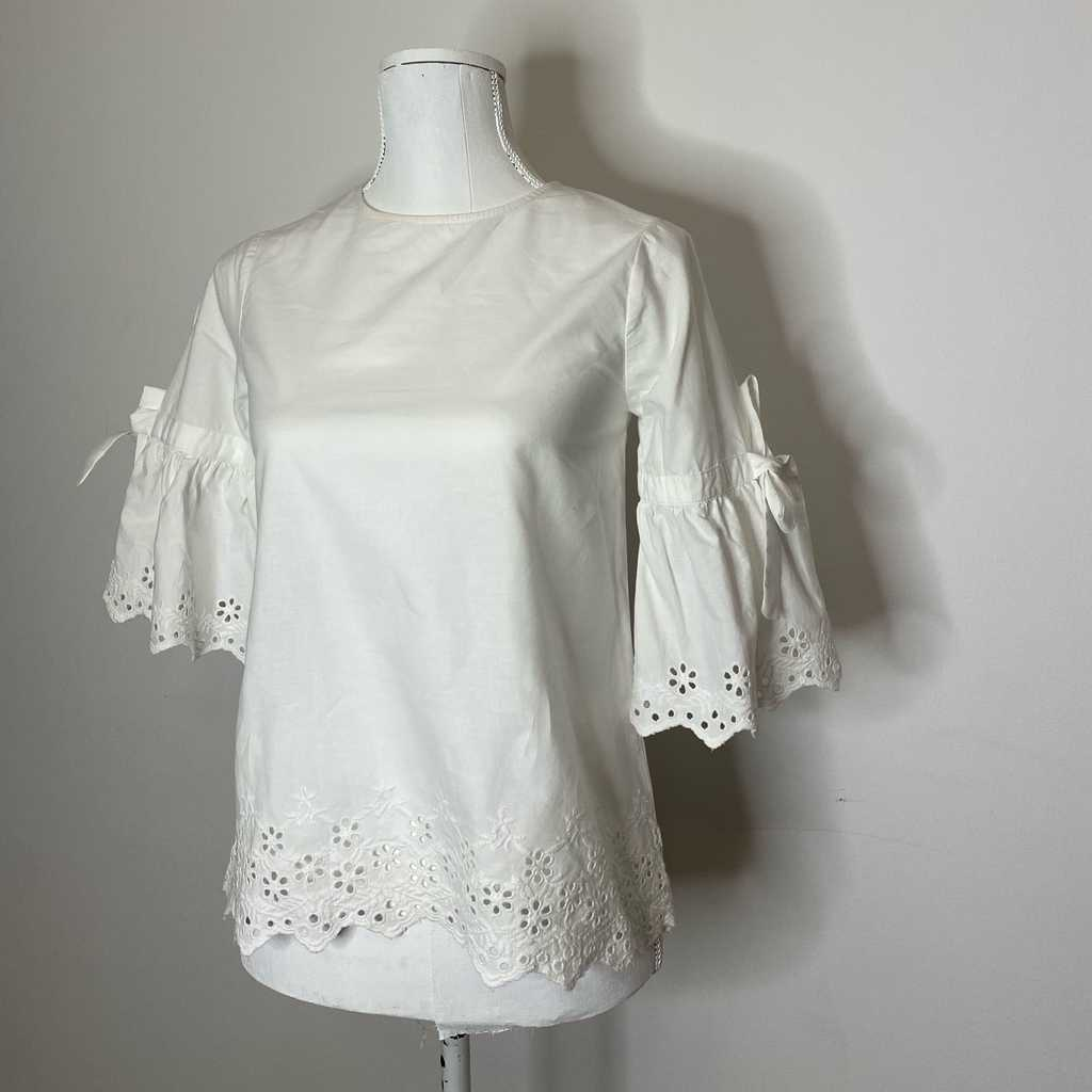 Pretty white top with lace cut out details