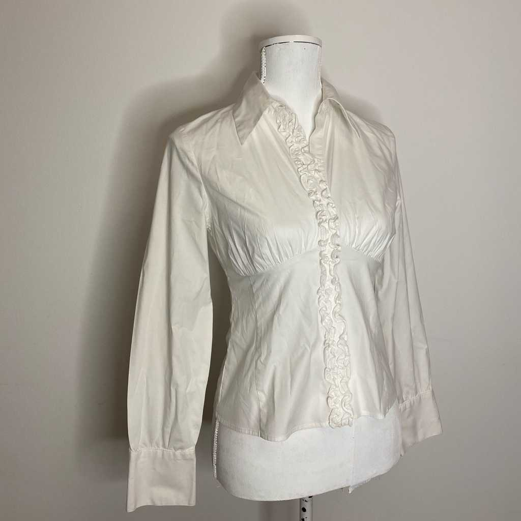 White work top with ruffle detail