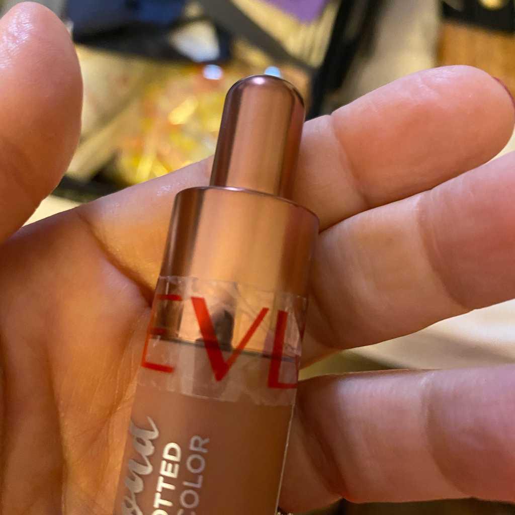 Revlon lip gloss. Unused. Still sealed.