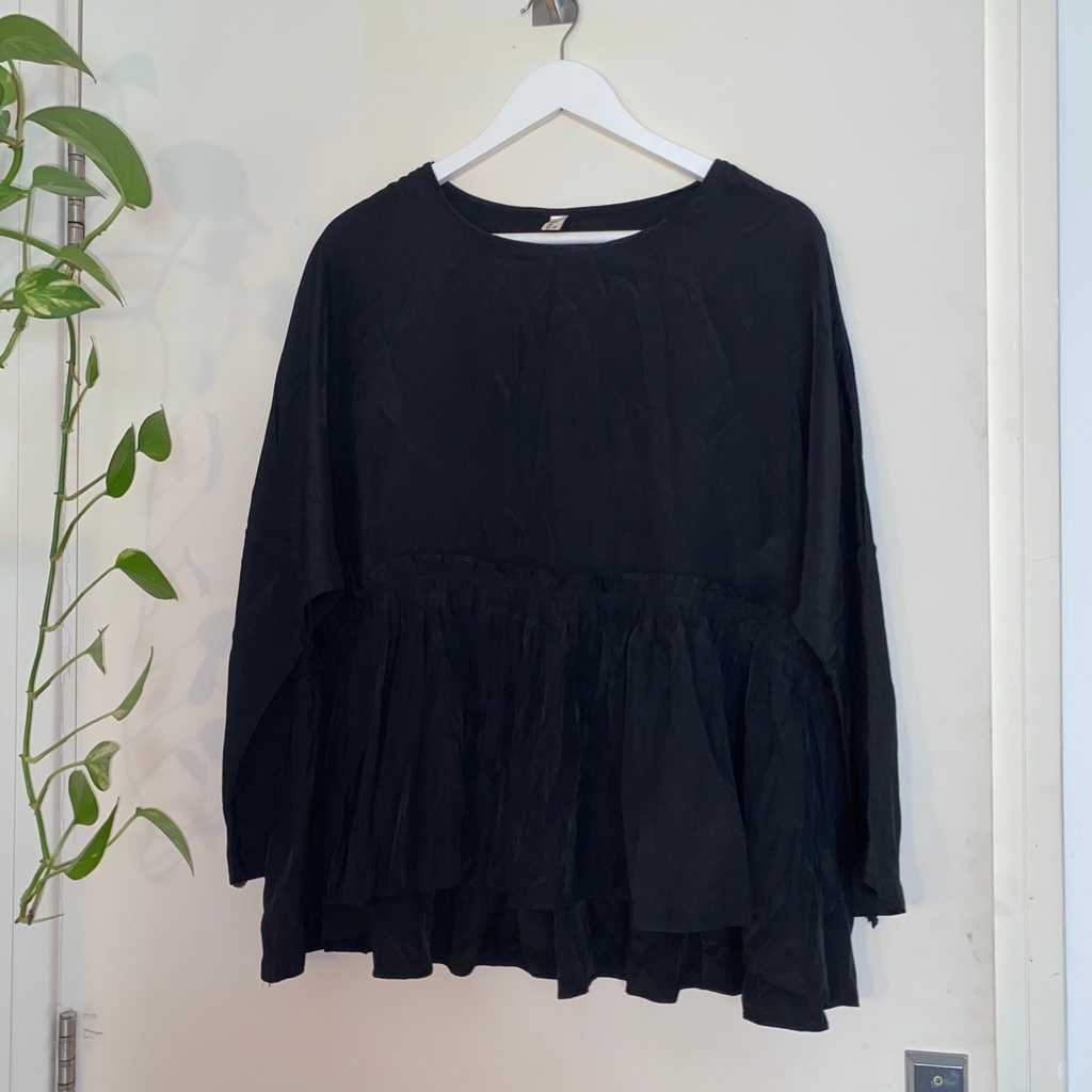 Black Loose Fitted Peplum Blouse