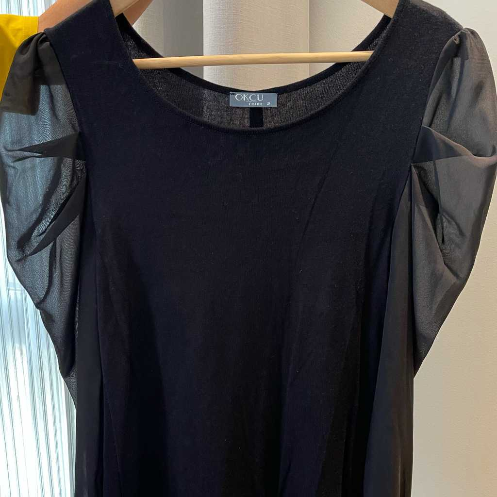 Black sweater with see through sleeves