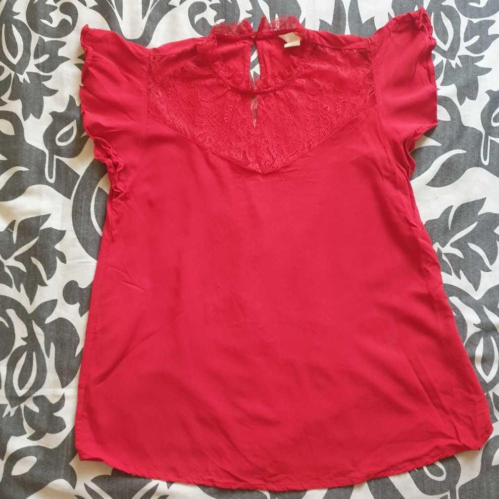 Orange ruffle sleeve blouse