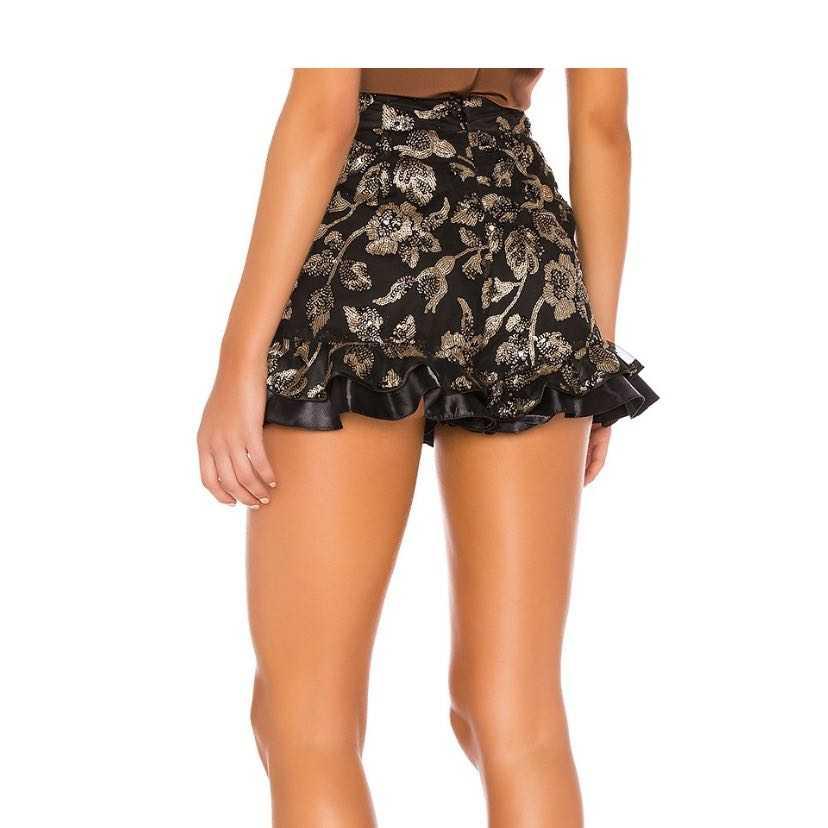 Frill hem shorts with gold embellishment