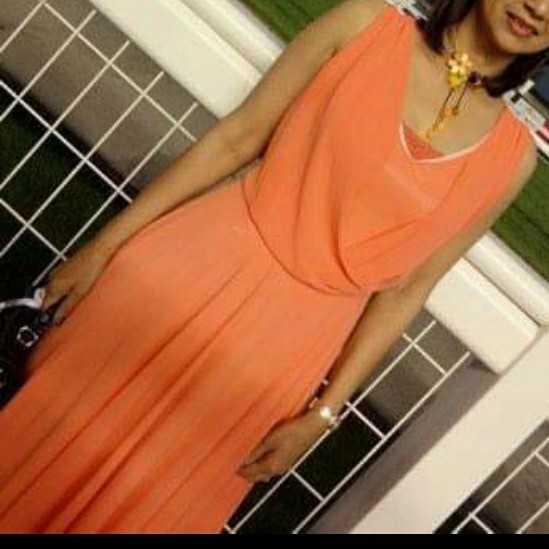 Long dress, sleeveless, and no vest dress